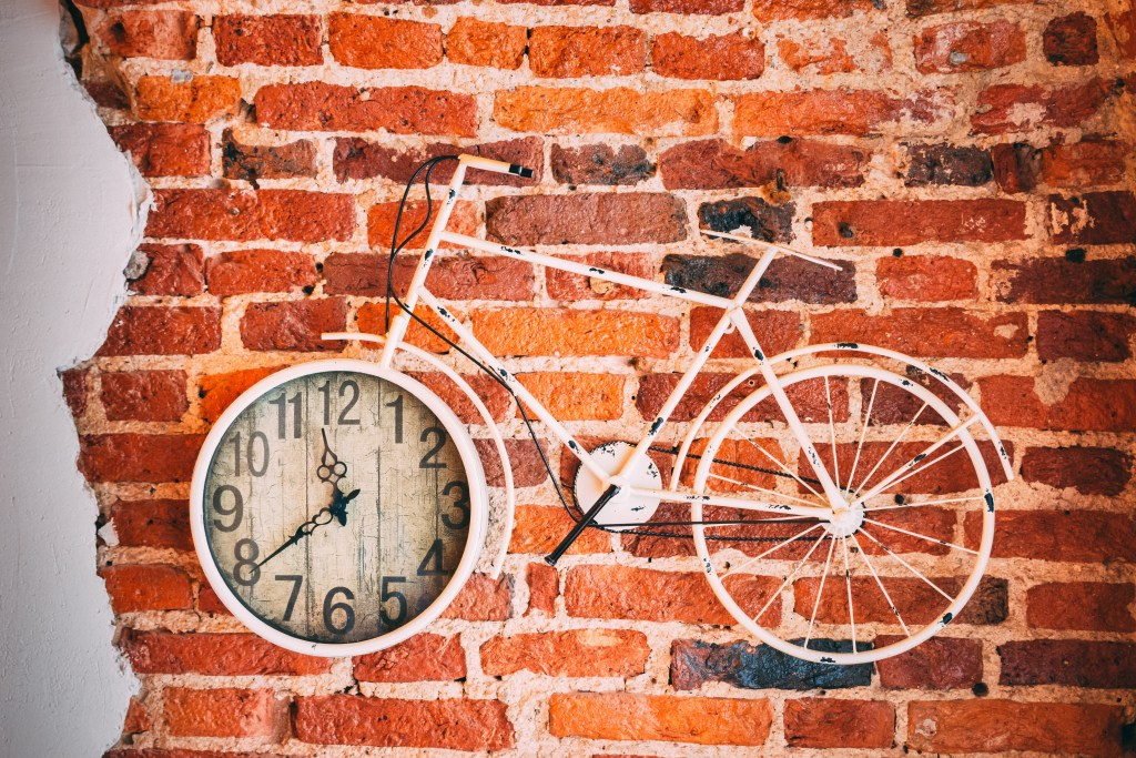 9 times tables trick bike on a wall with clock.